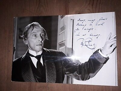 autograph 10x7 photo signed by Peter Cushing