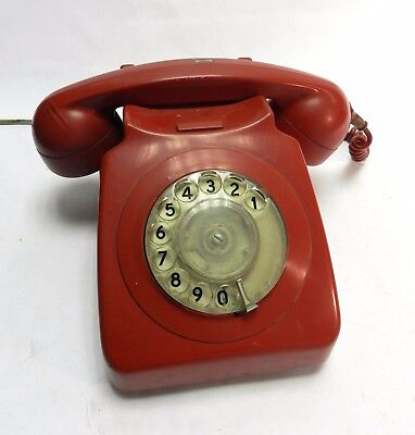 Vintage retro red telephone with cable. Good working condition