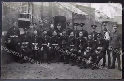 1900s Devonshire Regiment - Group with Old & New uniforms & pets- Real Photo PPC