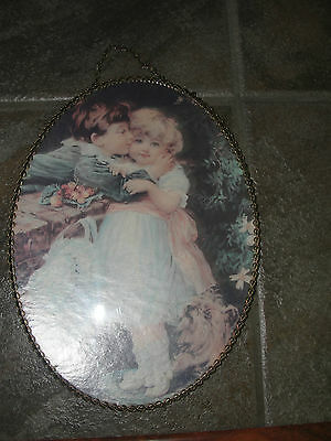 Oval glass protected flue cover of boy kissing girl,chain link frame, decorative