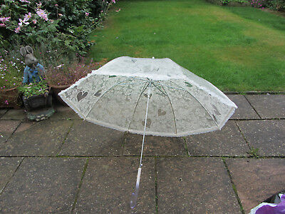 Wedding umbrella in lace/heart print plastic with frilled hem ivory