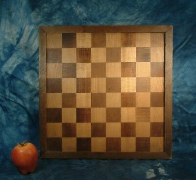 Vintage wooden inlaid chess board .