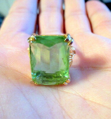estate costume ring gold tone with large emerald cut green glass insert .size 8