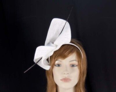 White & black fascinator with long feather by Max Alexander. RRP: $79.95