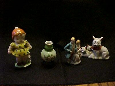 Four Occupied Japan Pieces / One Vase / Three Figurines