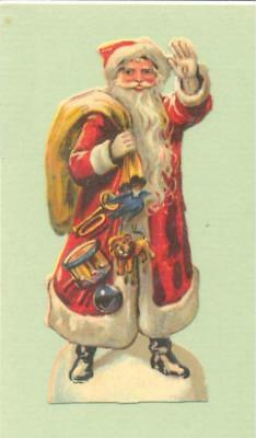 Victorian Die Cut Scrap, Santa with Christmas Toys.   P35b