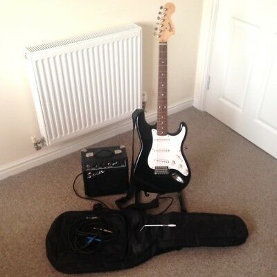 Squier Strat by Fender with Amp, Bag, Whammy Bar and Two Leads