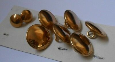 6 medium  &   2 small brass hollow  antique  buttons measuring   2cm  and 1 cm