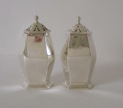 A Pair Of Sterling Silver Hexagonal Shaped Pepper Pots Sheffield 1916 67 Grams