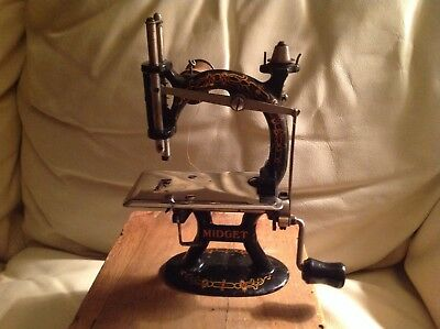 antique midget sewing machine with wood box