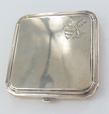 1920's .800 CONTINENTAL SILVER CIGARETTE CASE WITH UNUSUAL ARMORIAL MOTIF.