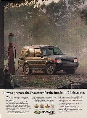 1995 Land Rover Discovery in Madagascar Jungle Getting Gas photo promo print ad