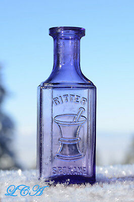 ANTIQUE transparent purple SPOKANE WASHINGTON picture bottle RITTER DRUG Company