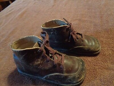 "vintage or antique pair of childs brown leather shoes approx 6"" long"