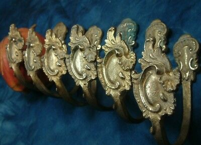 Antique lot of 6  Bronze curtain tie backs hooks .