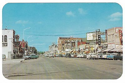 1950's GREELEY CO DOWNTOWN CAFE BAR OLD 8th AVENUE VINTAGE CARS POSTCARD