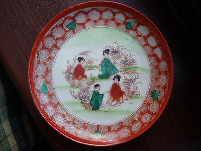 Japanese Small Plate decorated with Figures in a Garden ~ Kutani colours