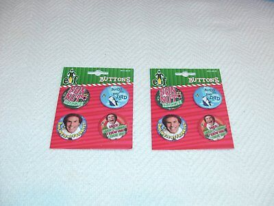 Two Packs Elf The Movie Buttonns/pins - 4 Different Patterns (8 Total Pins)