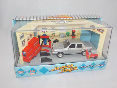 Motor Max  Moments in time 1982 Dodge Aries K Silver model garage diorama  1/64