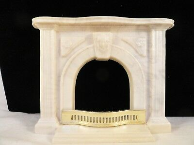 Cast Faux  Marble Fireplace With Brass Fender