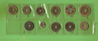 #d343.  Eleven(11) Chinese Cash Brass Coins