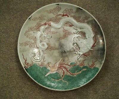 A large Rare Edo/Meiji period Arita Charger decorated with a Dragon & Phoenix.