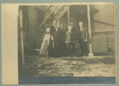 Vintage Photograph of Family Standing on Back Porch Under the Back Stairs