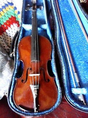 Old F size violin ,2 pc figured back.No Label. Case with 2 bows which come free