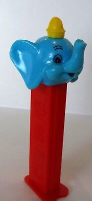 Old, Dumbo Elephant Pez, Pointy Top Hat. Red stem, Blue Face with Yellow Hat.
