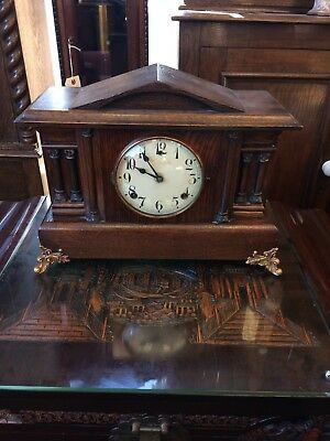Antique American Oak Mantle Clock with Brass Legs.