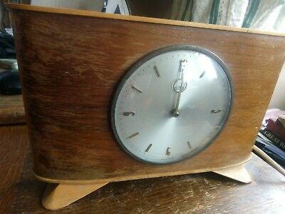 Stylish vintage wooden electric clock.  Metamec Dereham. Made in England