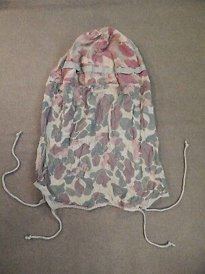 WWII / WW2 U.S. Army Camouflage M1 Helmet Cover with Camouflage Insect Netting.