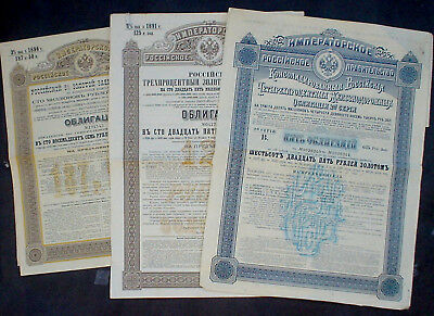 3 x Russia 1 x 481 US$ Gold Dollars Bond 98 £ + 2 x 96$ 1889 uncanc + coupons
