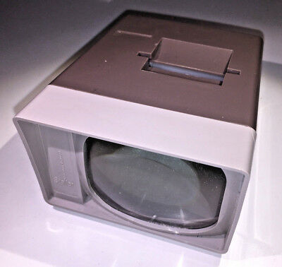A classic Photax Stellar handheld viewer for 35mm slides, 1970s with box