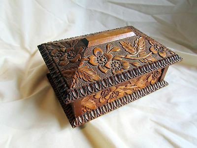 A Vintage Carved Wooden Box From Switzerland