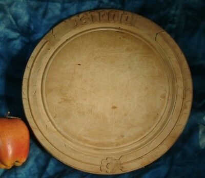 Antique hand carved wooden bread board gothic bread .