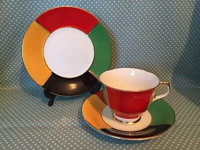 Vintage H M Sutherland China Harlequin cup, saucer & side plate trio.