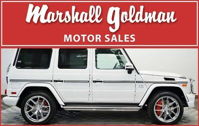 2016 Mercedes-Benz G-Class  2016 Mercedes Benz G65 in Polar White over Classic Red with only 6,500 miles