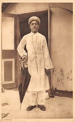 India Ethnic A Borah Native Man Poses By Front Door With Umbrella Printed Card