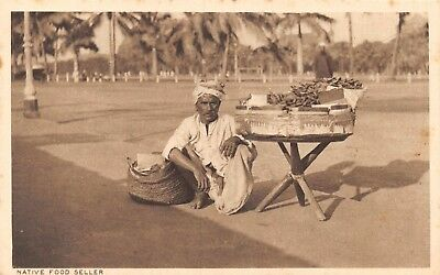 India Ethnic Native Food Seller Man Squats By Table Of Food Printed Card