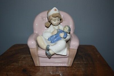 Lladro Nao Hand-Crafted Porcelain Nurse Girl In Chair With Doll
