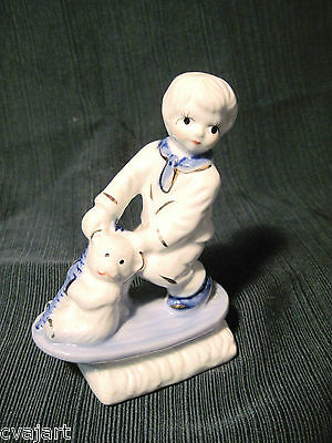 Vintage Blue & White Figurine Boy On Sled With Teddy Bear