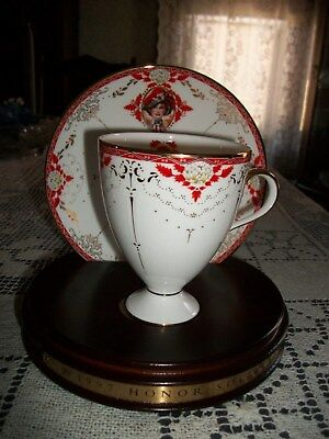 Avon Honor Society 1997 Cup and Saucer w/Wood Stand Bone China  Nikko Japan