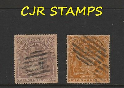Rhodesia 1898  ₤10 & ₤20  Arms    -     Forged Cancels   -    Filled Perfin