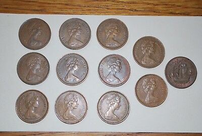 Lot of 12 copper British Coins; One 1/2 penny & Eleven 2-New Pence