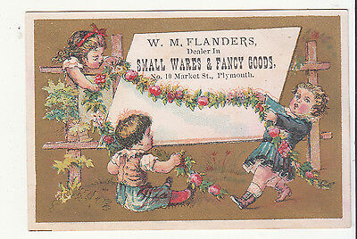 W M Flanders Small Wares & Goods Plymouth MA Floral Garland Vict Card c1880s