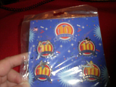 Disney Booster Collection 10 years of Pin Trading Set New 4 pins