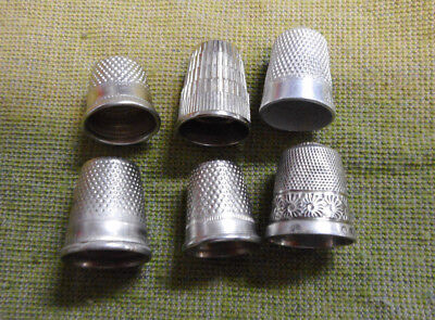 #D147.  Six(6) Sewing Thimbles, Two Are Silver