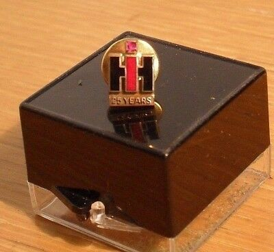 IH -- 10K Gold Lapel Pin w/ Ruby chip --  International Harvester 5-Year Pin