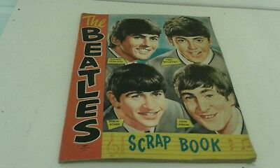 The Beatles Scrapbook Original 1964 filled with pictures of Beatles and others.